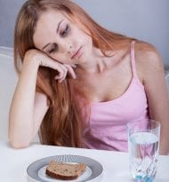 Girl on diet can't eat breakfast, vertical